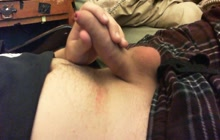 Playing with his small cock on the bed