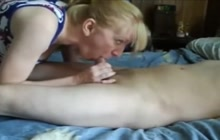 Mature blonde giving a blowjob and a handjob